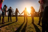 25188963-multiracial-young-people-holding-hands-in-a-circle